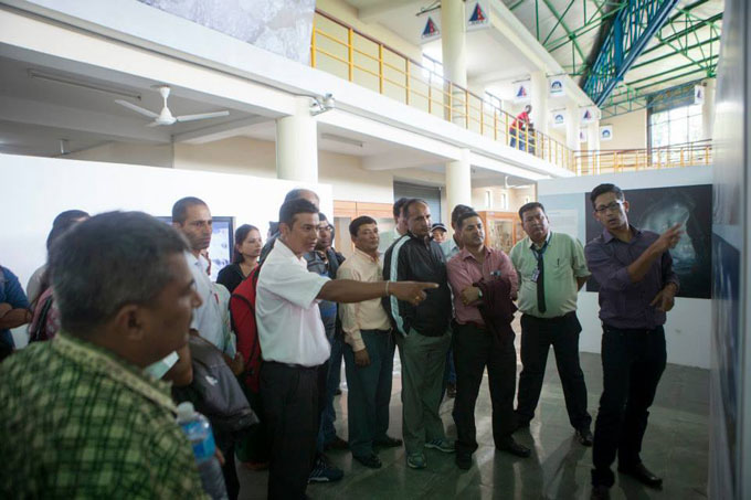 Niranjan Kunwar gives visiting school teachers and principals a guided tour. Photo: Shikhar Bhattarai